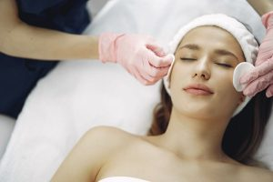 Lady receiving a facial treatment - The Hair and Beauty Rooms, Chislehurst