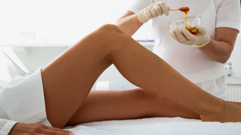 Lady having her legs waxed