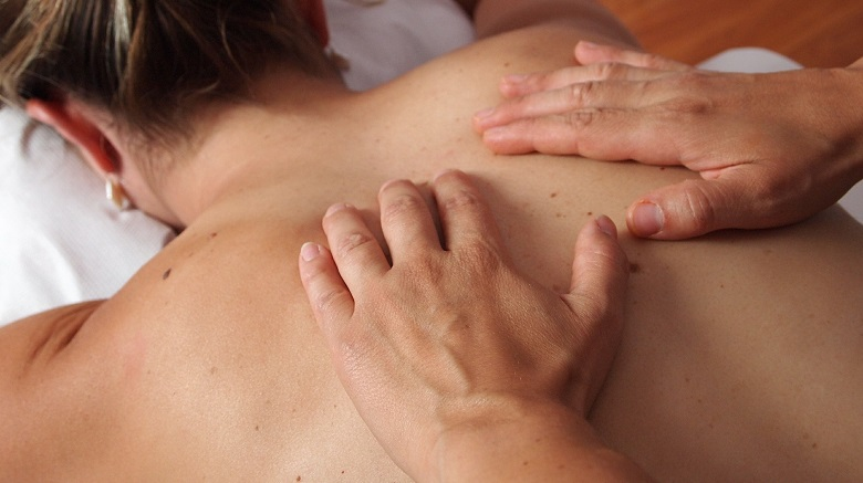 Lady receviing a body treatment massage
